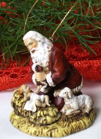 Santa Knelling Before Baby Jesus